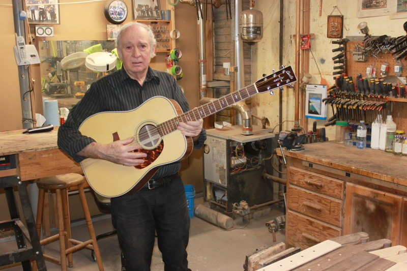 Bernie Coville displays one of the guitars made at his Johnstown workshop. JOURNAL PHOTO/MARTELLE