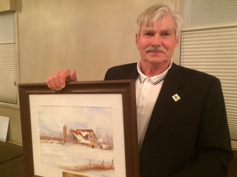 Adrian Wynands with the painting he received as recipient of 2018 Grenville Federation of Agriculture Award of Merit.  LYNN MACNAB PHOTO